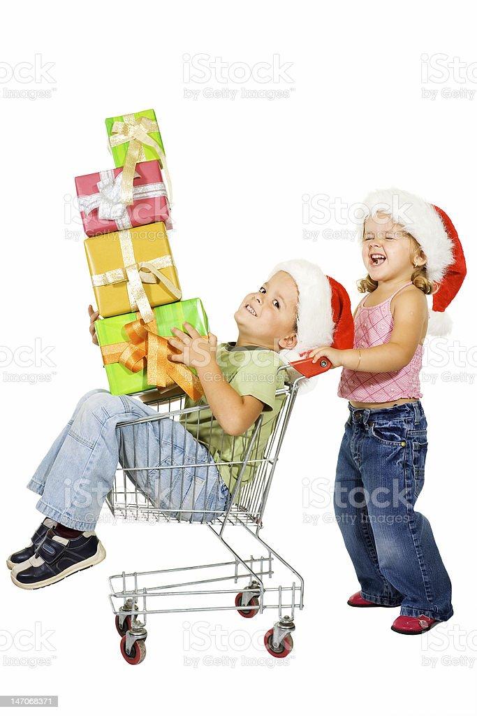 Happy kids christmas shopping royalty-free stock photo