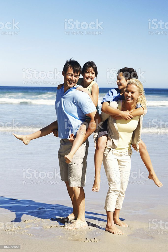 Happy kids getting piggy back rides royalty-free stock photo