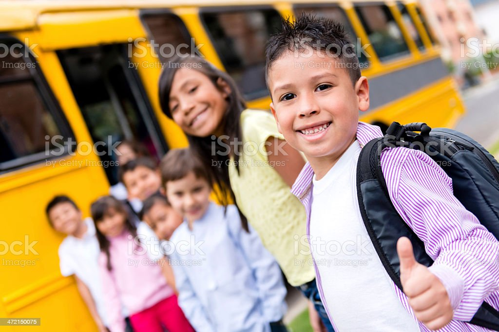 Happy kids going to school stock photo