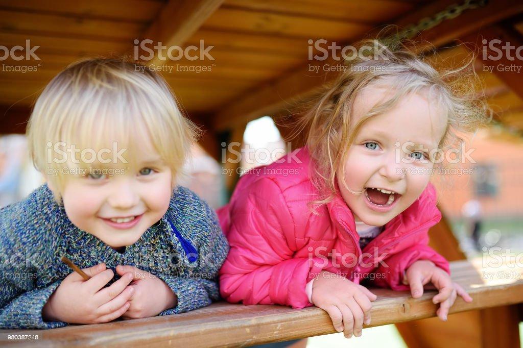 Happy kids having fun on outdoor playground stock photo