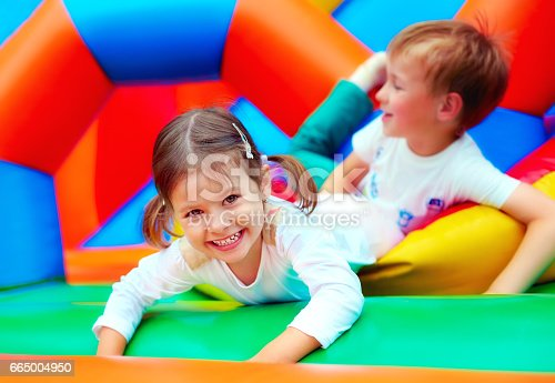 istock happy kids having fun on playground in kindergarten 665004950
