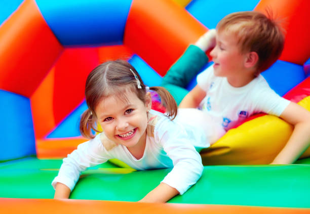 happy kids having fun on playground in kindergarten stock photo