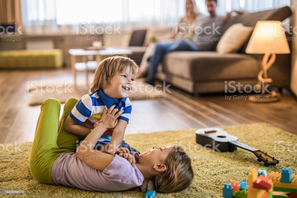 Happy Kids Having Fun While Playing On Carpet In The Living Room Stock Photo Download Image Now Istock