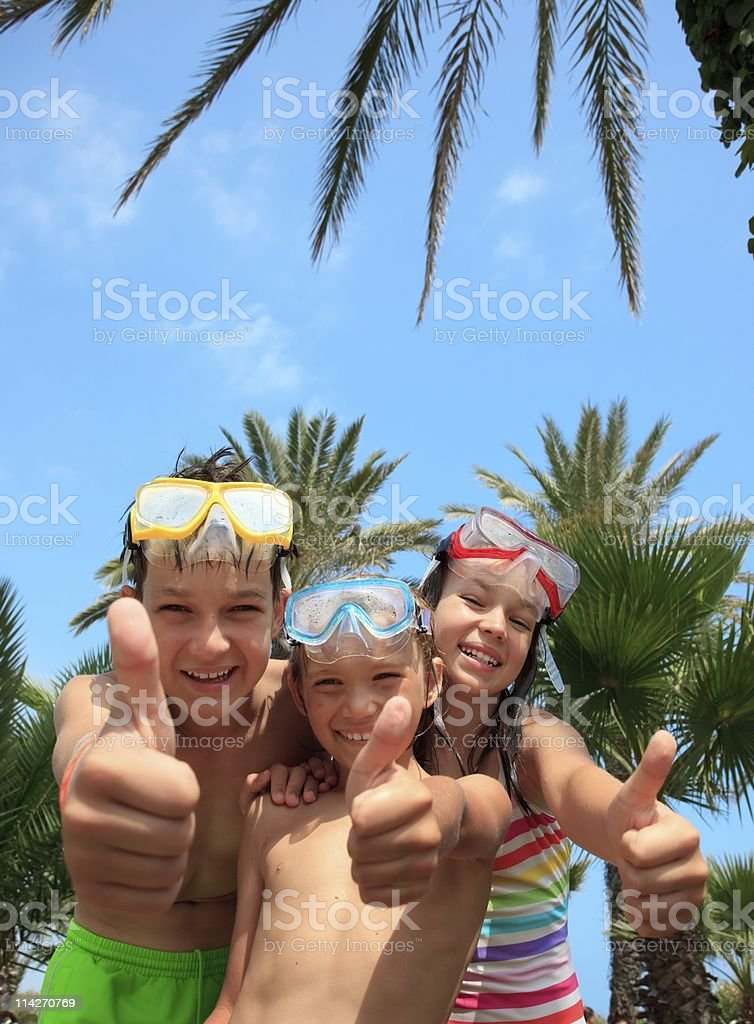 Happy kids in snorkel masks royalty-free stock photo
