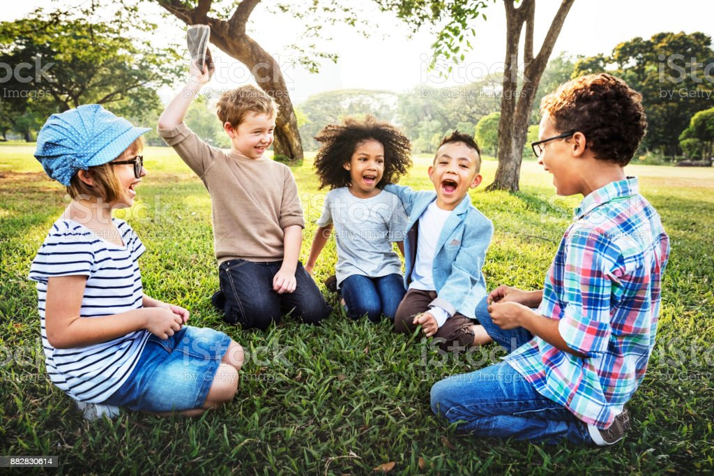 Happy kids in the park stock photo