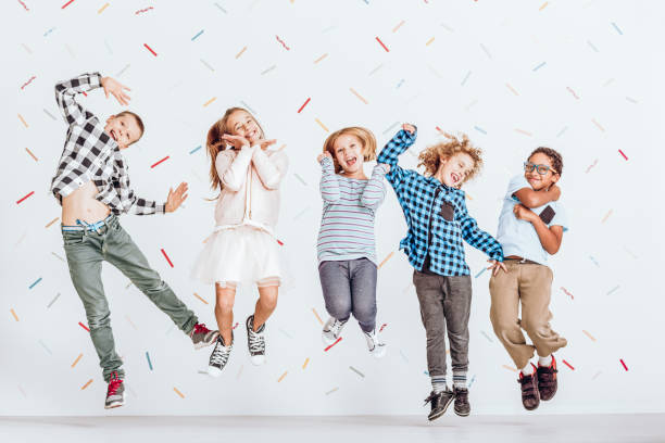 Happy kids jumping stock photo