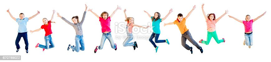istock Happy kids jumping 670789022