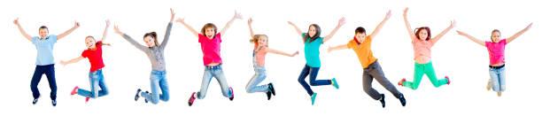 Happy kids jumping ストックフォト