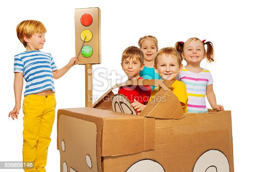 496487362 istock photo Happy kids playing and studying traffic code 539856146