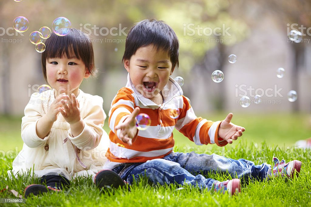 happy kids playing together royalty-free stock photo