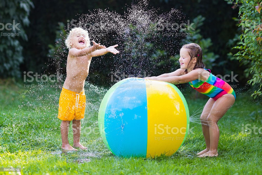 Happy kids playing with water ball toy royalty-free stock photo