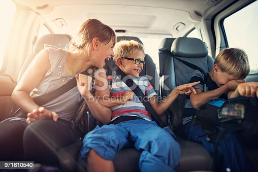 istock Happy kids travelling by car 971610540