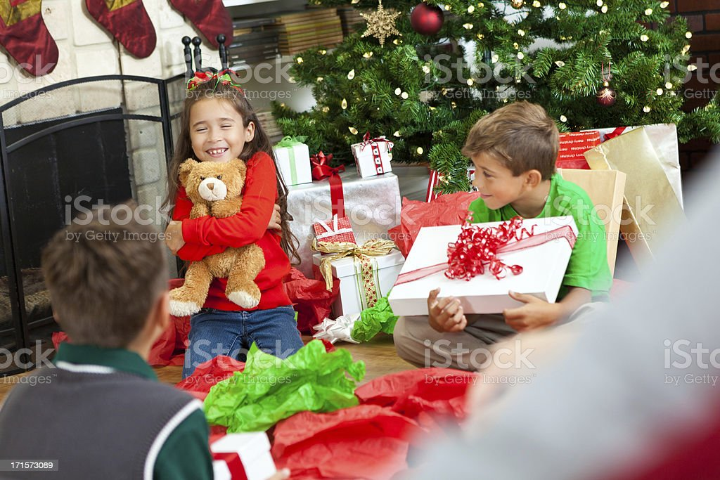 Happy Kids Unwrapping Toys And Presents On Christmas Morning Stock ...