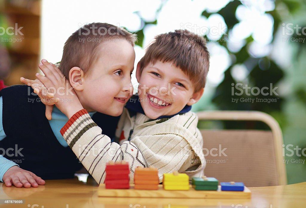 happy kids with disabilities in preschool stock photo