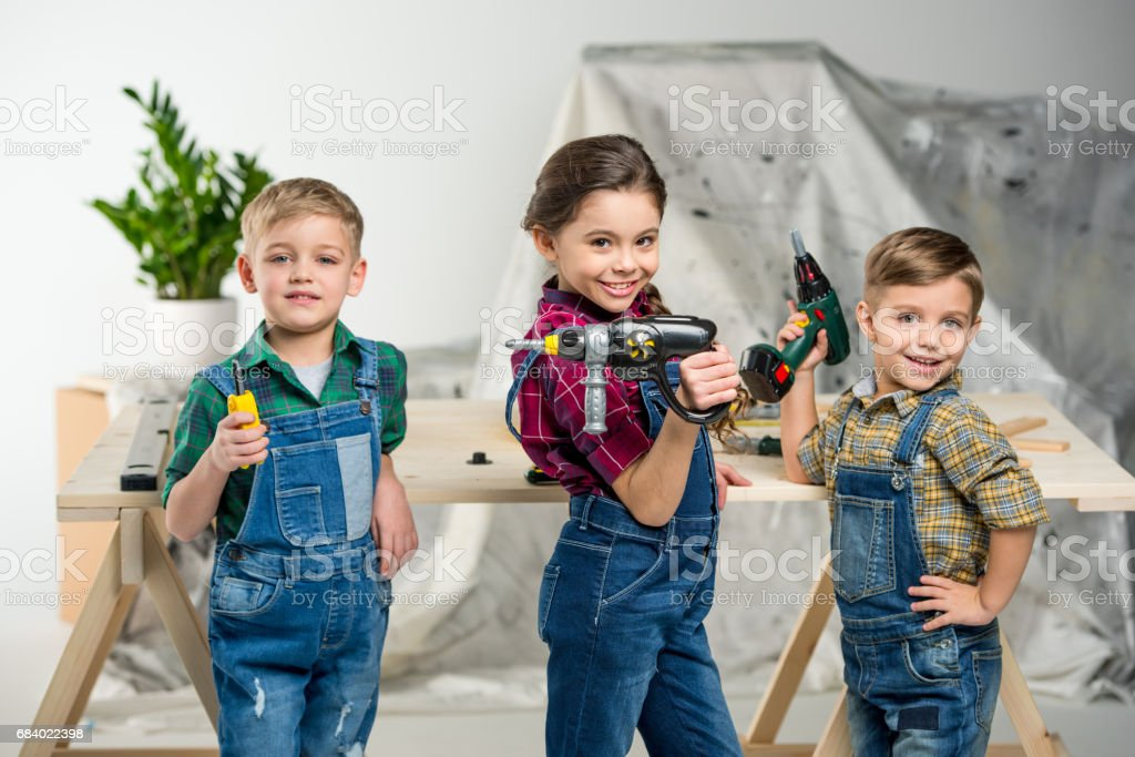 Happy kids with tools stock photo