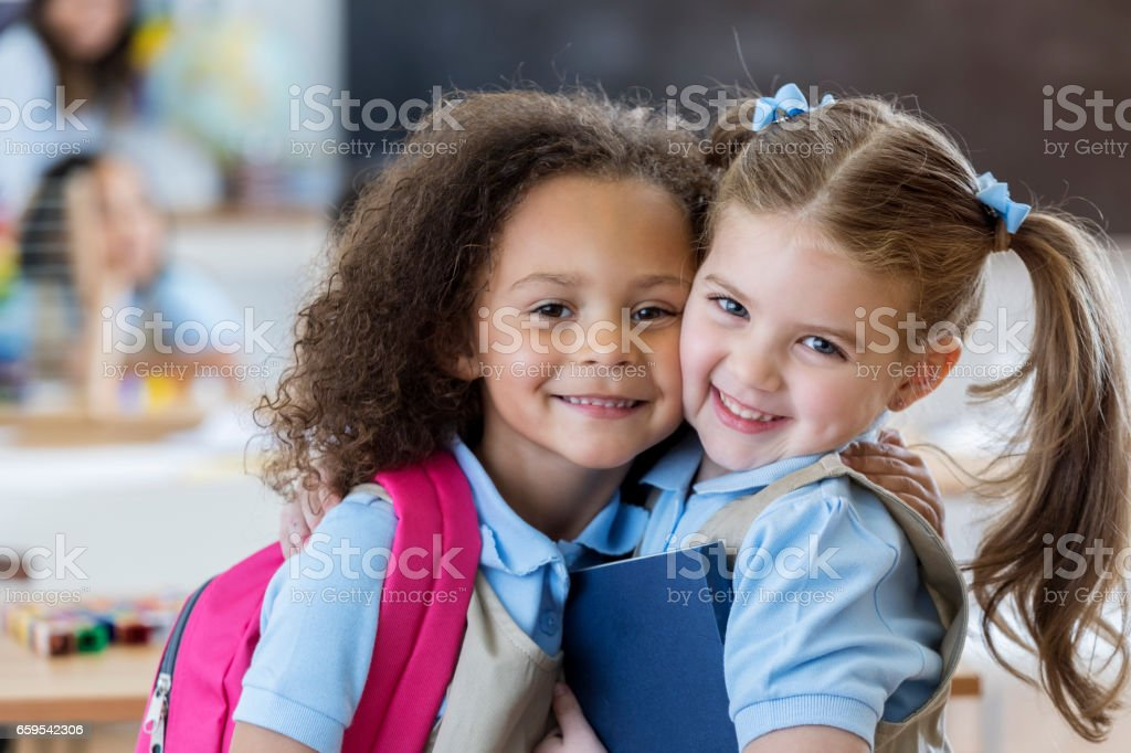 Happy kindergarten schoolgirls stock photo