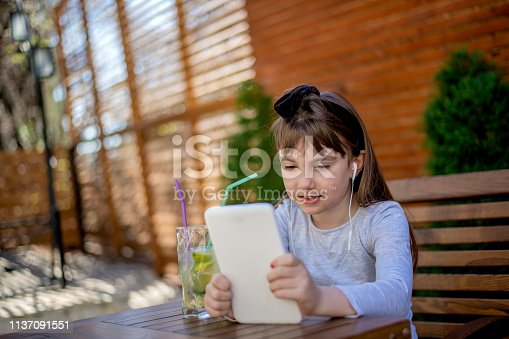 655532196 istock photo Happy kindergarten student smiles while using digital tablet technology 1137091551