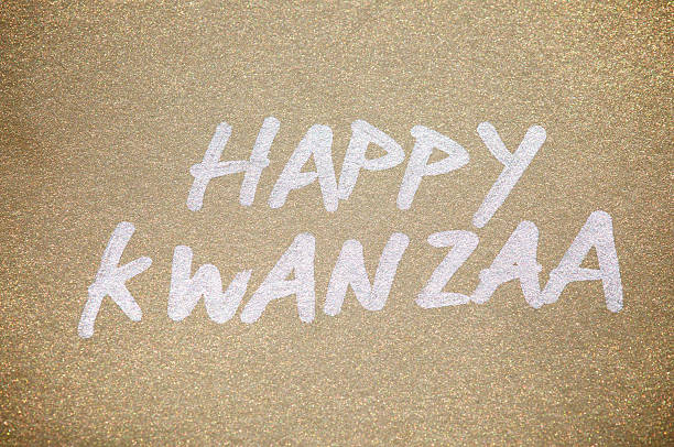 happy kwanzaa message in silver on gold paper - kwanzaa stock pictures, royalty-free photos & images