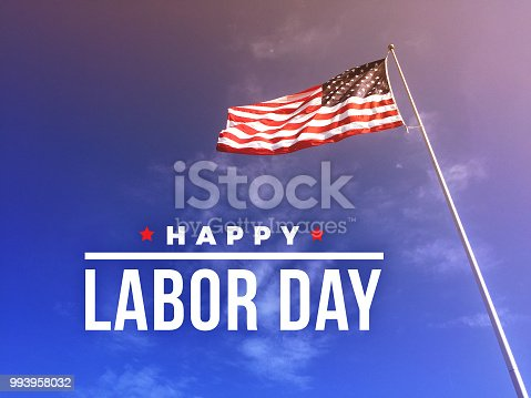 Happy Labor Day Text Over American Flag Blowing in the Wind