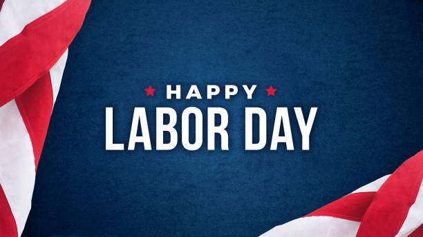 Happy Labor Day Text Over Dark Blue Background with American Flags stock photo