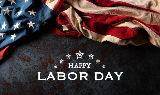 Happy labor day text with America flag over black stone texture background. Happy labor day text with America flag over black stone texture background. labor day stock pictures, royalty-free photos & images
