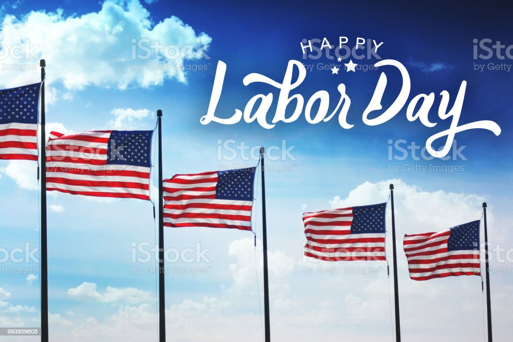 Happy Labor Day Text with Row of American Flags stock photo