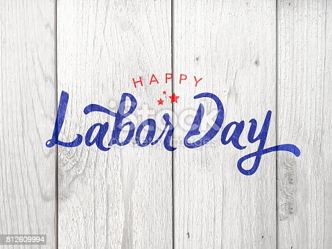 istock Happy Labor Day Typography Over Wood 812609994