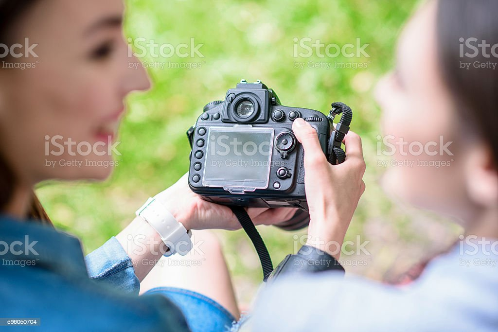 Happy ladies entertaining with photographs royalty-free stock photo