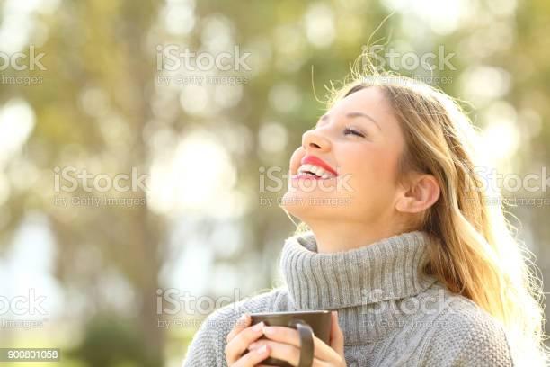 Happy lady breathing fresh air in winter picture id900801058?b=1&k=6&m=900801058&s=612x612&h=wej5qmzw8t2obzcdnfcn5urybw8inm1llm4sj1u2fdi=