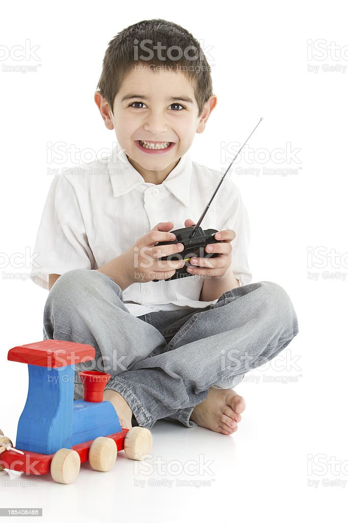 Happy latin american boy with remote controlled car stock photo