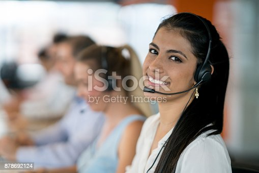 istock Happy Latin American woman working at a call center 878692124