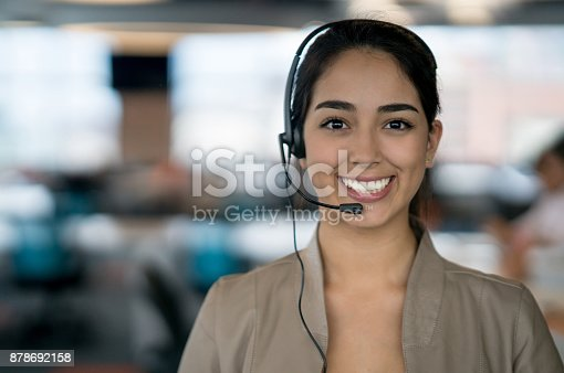 istock Happy Latin American woman working at a call center 878692158