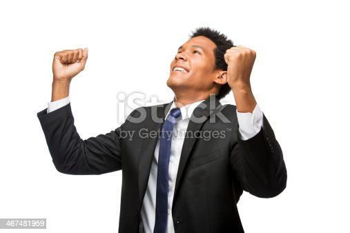 istock Happy latin business man with arms raised 467481959