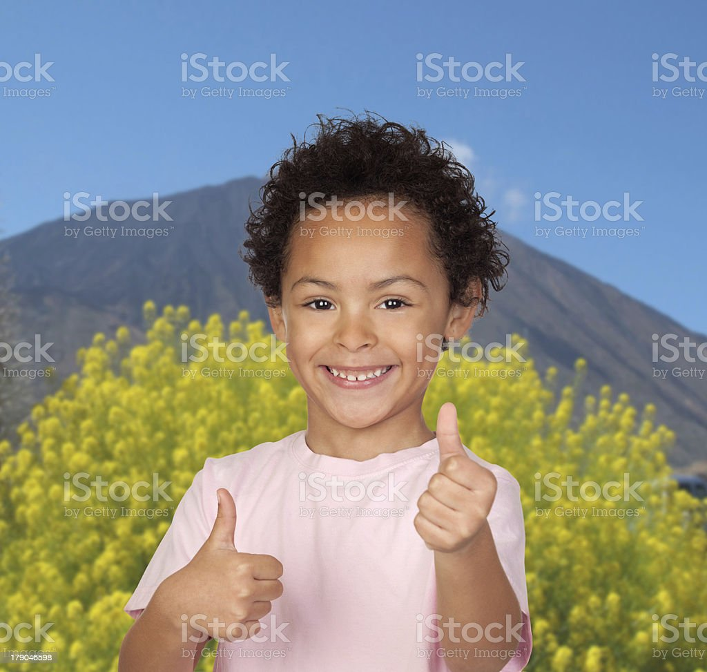 Happy latin child saying Ok with a volcano royalty-free stock photo