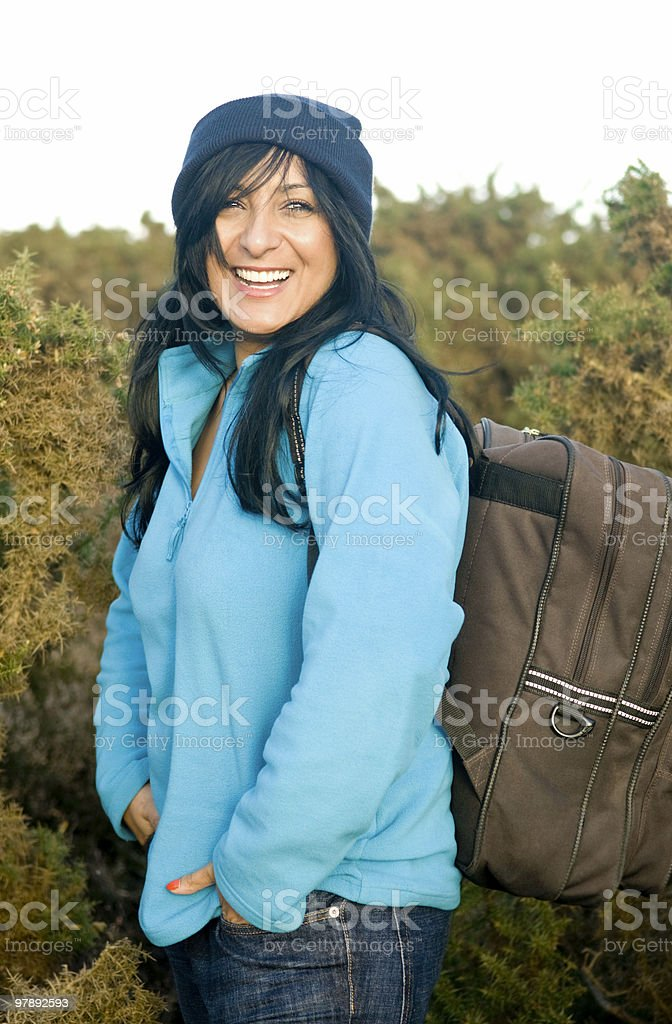 happy laughing asian female carrying rucksack royalty-free stock photo