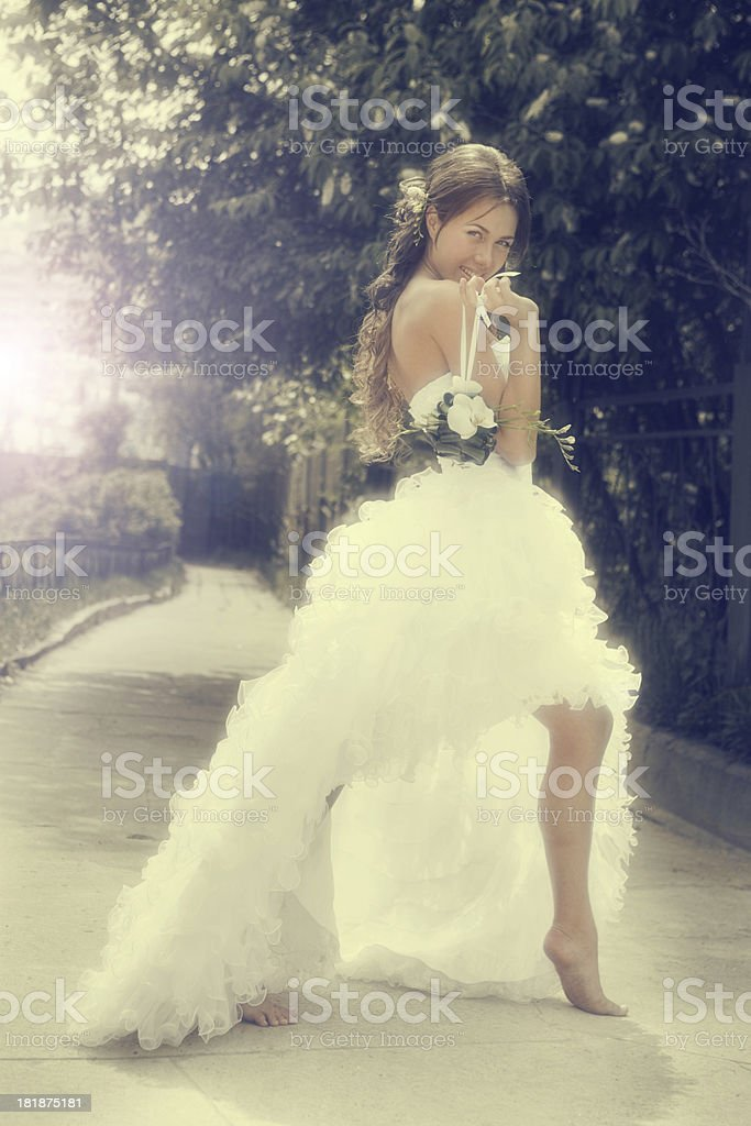 Happy Laughing Bride Standing Outdoor with Bouquet of Orchids. royalty-free stock photo