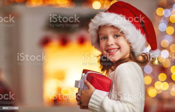 Happy laughing child girl with christmas present at home picture id868220486?b=1&k=6&m=868220486&s=612x612&h=vik6xf2rk5ejmhurk3 0yv6 1jaq2id29qehvlvmf1q=