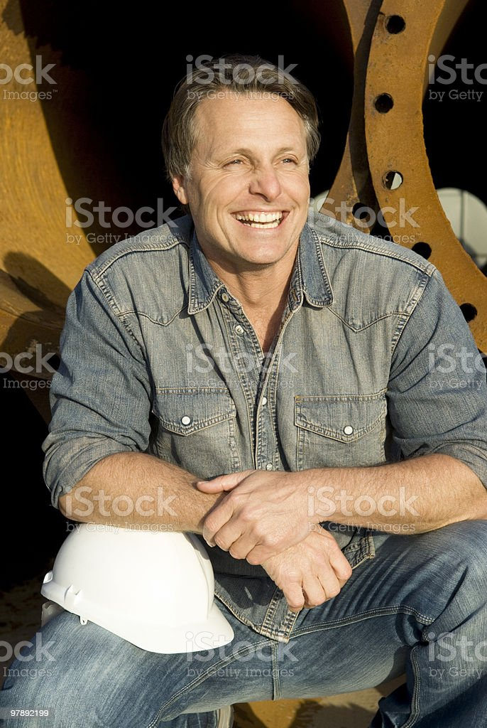 Happy laughing construction worker. royalty-free stock photo