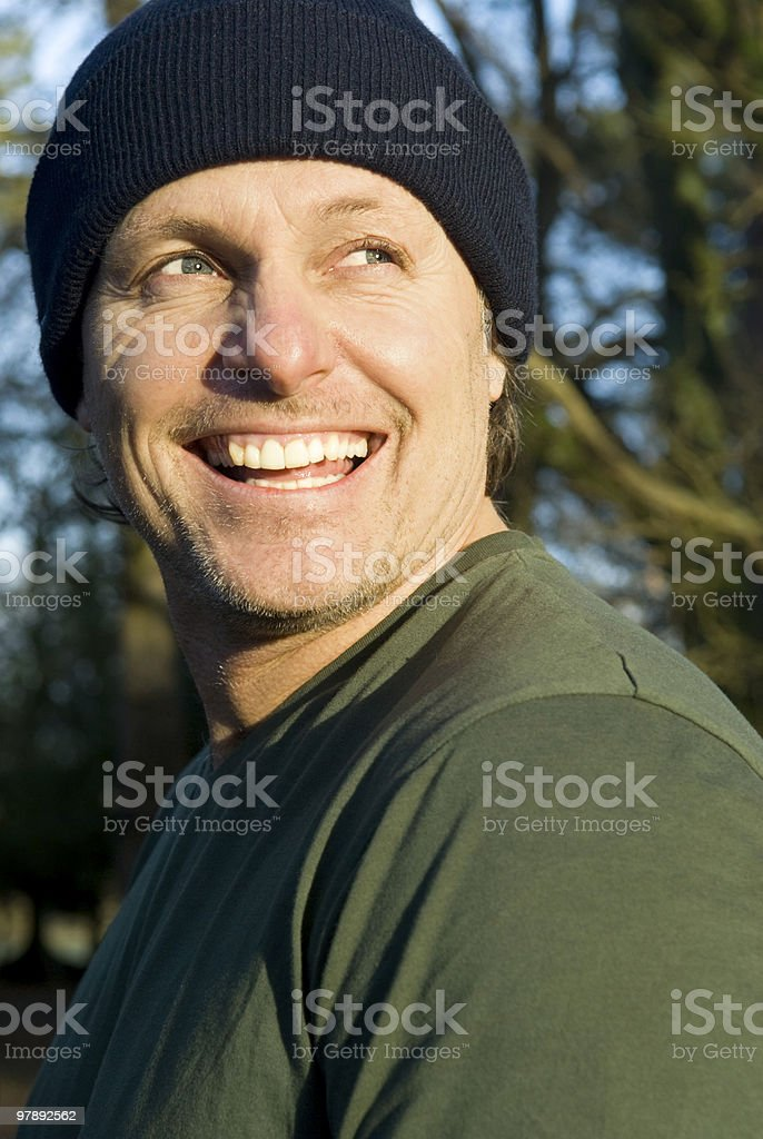 happy laughing forties man wearing hat royalty-free stock photo