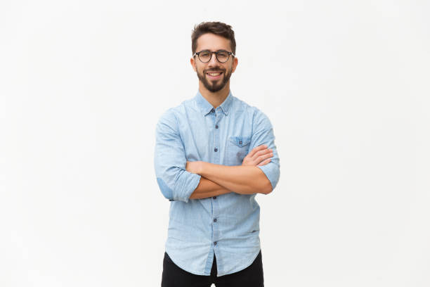 Happy laughing guy posing with arms folded stock photo