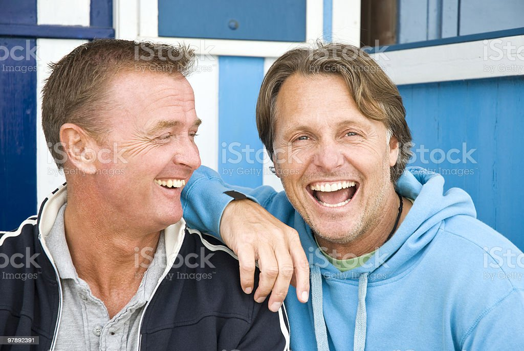 Happy laughing homosexual couple. royalty-free stock photo