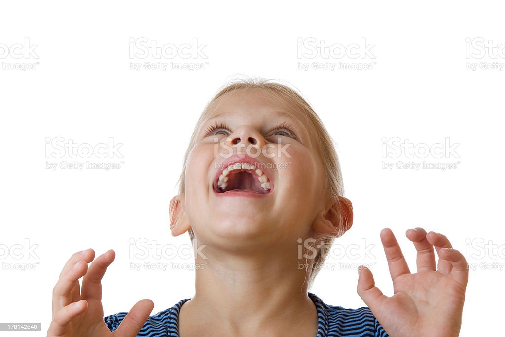 Happy laughing little blond girl looking up on white royalty-free stock photo