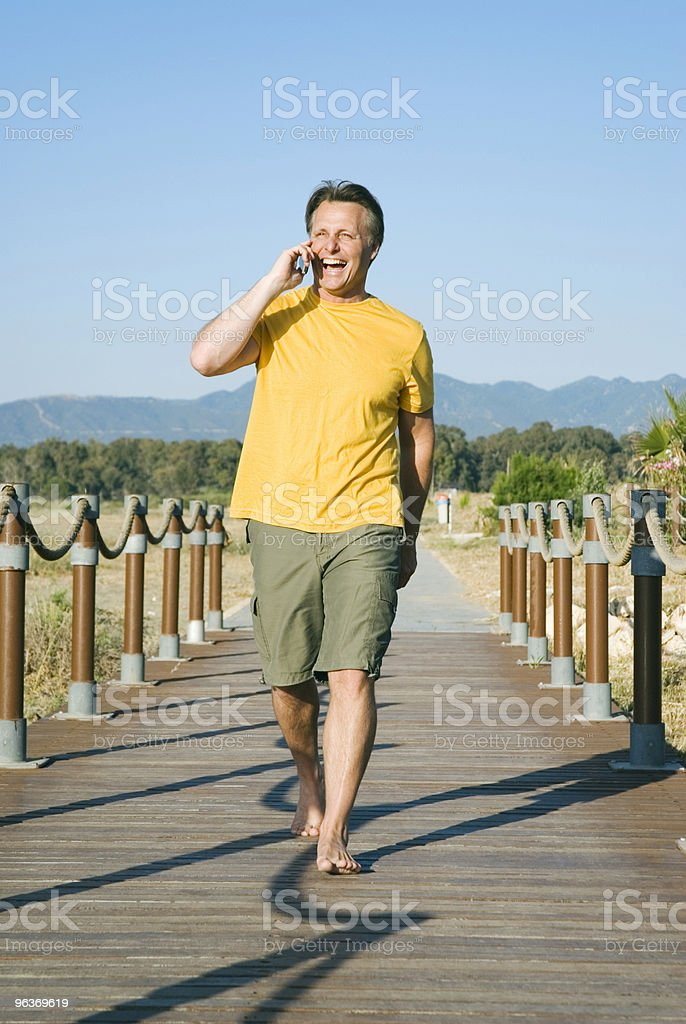 Happy laughing man on mobile phone royalty-free stock photo