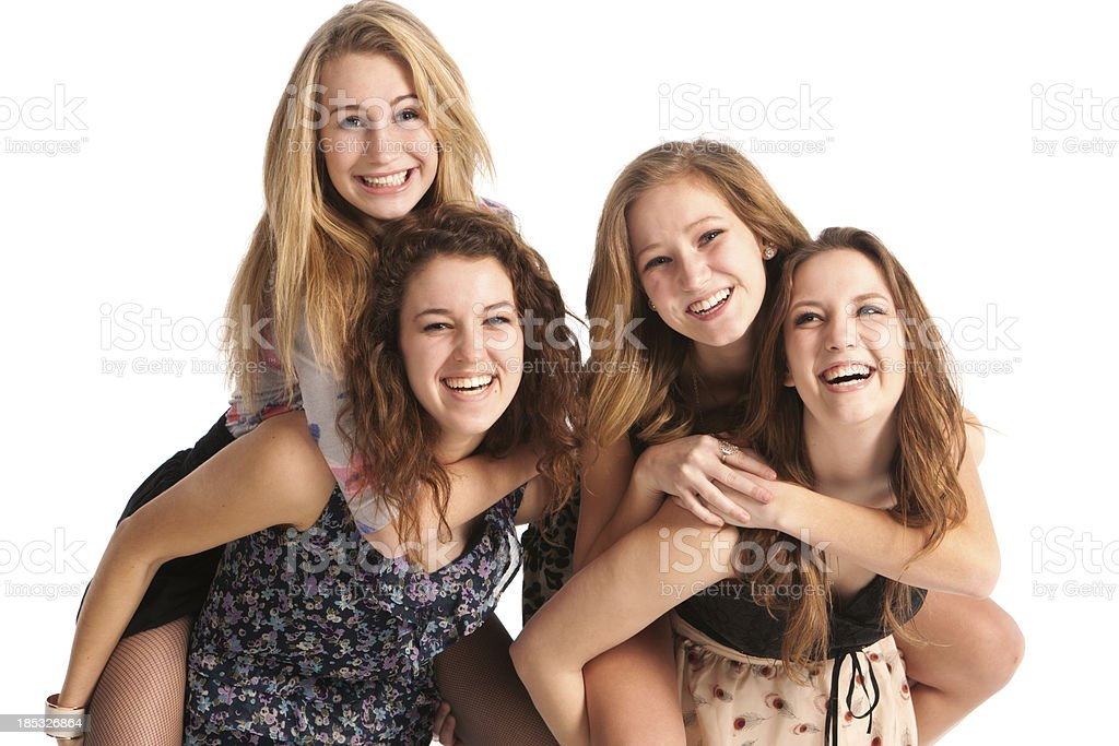 Happy Laughing Playful Young Teen Girls Friends in White Background stock photo