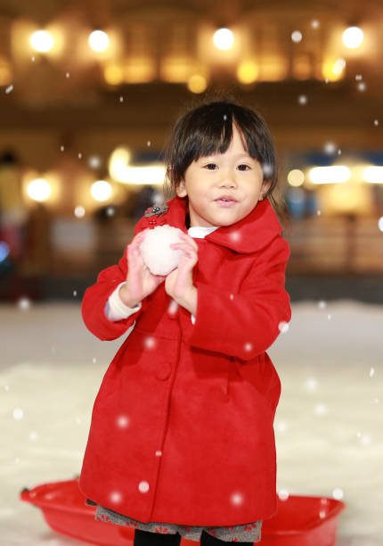 dce3c5a7c Happy Laughing Toddler Girl Wearing A Red Jacket Has A Fun In Snow ...