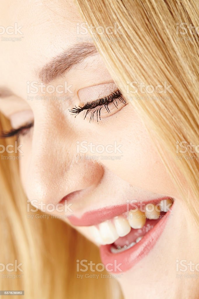 Happy laughing young blond woman stock photo