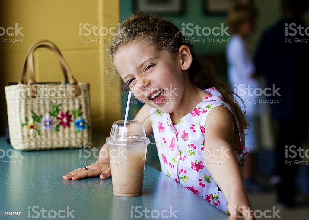 happy laughing young girl in a gelato store royalty-free stock photo