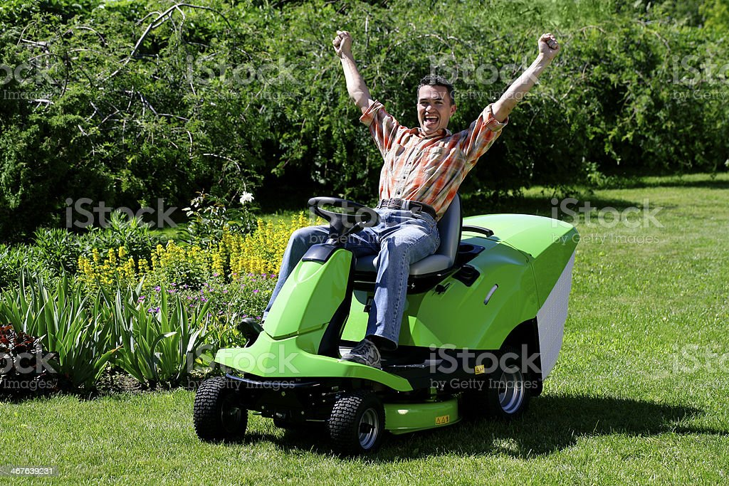 Happy lawnmower man stock photo