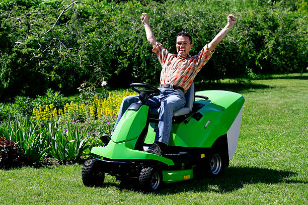 happy lawnmower man - riding lawn mower stock photos and pictures