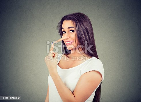 istock Happy liar woman with long nose 1131156068